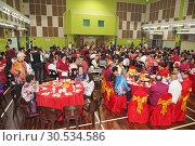 Chinese New Year dinner at Sungai Maong Community Hall, Kuching, Sarawak, Malaysia (2019 год). Редакционное фото, фотограф Chua Wee Boo / age Fotostock / Фотобанк Лори