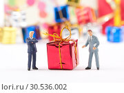 Купить «Figurines of two businessmans with Christmas gift», фото № 30536002, снято 12 ноября 2010 г. (c) Tryapitsyn Sergiy / Фотобанк Лори