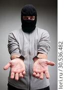 Criminal in handcuffs asking for freedom. Стоковое фото, фотограф Tryapitsyn Sergiy / Фотобанк Лори