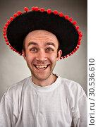 Купить «Laughing man in sombrero hat», фото № 30536610, снято 14 марта 2011 г. (c) Tryapitsyn Sergiy / Фотобанк Лори