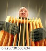 Freezing man holding hot oil radiator. Стоковое фото, фотограф Tryapitsyn Sergiy / Фотобанк Лори