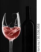 Купить «Broken glass with bottle on background», фото № 30536958, снято 20 апреля 2011 г. (c) Tryapitsyn Sergiy / Фотобанк Лори