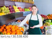 Купить «Young woman selling fresh oranges and fruits», фото № 30538430, снято 29 мая 2020 г. (c) Яков Филимонов / Фотобанк Лори
