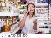 Купить «girl choosing new perfume», фото № 30538530, снято 31 января 2018 г. (c) Яков Филимонов / Фотобанк Лори