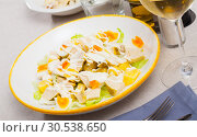 Купить «Dish with appetizing chicken salad, eggs and pineapples», фото № 30538650, снято 7 июля 2020 г. (c) Яков Филимонов / Фотобанк Лори