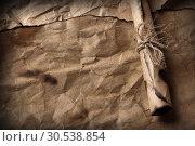 Купить «Old paper with rolled message», фото № 30538854, снято 7 июня 2012 г. (c) Tryapitsyn Sergiy / Фотобанк Лори