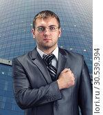Businessman with hand over heart. Стоковое фото, фотограф Tryapitsyn Sergiy / Фотобанк Лори