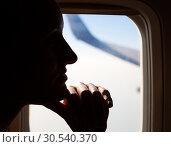 Купить «Young woman flying in airplane», фото № 30540370, снято 9 июля 2013 г. (c) Tryapitsyn Sergiy / Фотобанк Лори
