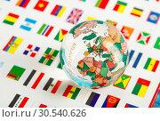 Glass globe on the flags. Стоковое фото, фотограф Tryapitsyn Sergiy / Фотобанк Лори