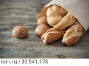 Купить «baguette on old wooden background», фото № 30541178, снято 26 марта 2019 г. (c) Майя Крученкова / Фотобанк Лори