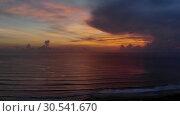 Купить «Idyllic drone footage of ocean against cloudy sky during sunset.», видеоролик № 30541670, снято 9 апреля 2019 г. (c) Женя Канашкин / Фотобанк Лори