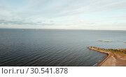 Купить «View from the drone on the sandy beach and the coast of the Gulf of Finland, on the horizon the districts of St. Petersburg», видеоролик № 30541878, снято 9 апреля 2009 г. (c) Куликов Константин / Фотобанк Лори