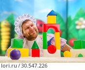 Man weared as baby play indoor. Стоковое фото, фотограф Tryapitsyn Sergiy / Фотобанк Лори