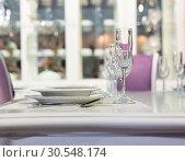 Купить «Served fashion table in white colors», фото № 30548174, снято 29 мая 2014 г. (c) Tryapitsyn Sergiy / Фотобанк Лори