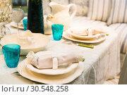 Купить «Served fashion table with glases and plates», фото № 30548258, снято 29 мая 2014 г. (c) Tryapitsyn Sergiy / Фотобанк Лори