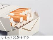 Купить «Box of cigarettes», фото № 30549110, снято 6 сентября 2014 г. (c) Tryapitsyn Sergiy / Фотобанк Лори
