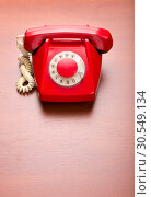 Купить «Red retro telephone», фото № 30549134, снято 6 сентября 2014 г. (c) Tryapitsyn Sergiy / Фотобанк Лори