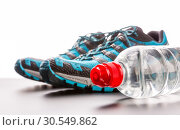 Sports runners and a bottle of water. Стоковое фото, фотограф Tryapitsyn Sergiy / Фотобанк Лори