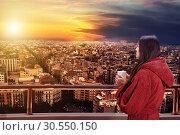 Купить «Woman on the balcony», фото № 30550150, снято 19 ноября 2014 г. (c) Tryapitsyn Sergiy / Фотобанк Лори