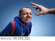 Fillip on forehead. Стоковое фото, фотограф Tryapitsyn Sergiy / Фотобанк Лори