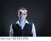 Купить «Strange man with necktie on his head», фото № 30551070, снято 5 марта 2015 г. (c) Tryapitsyn Sergiy / Фотобанк Лори