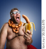 Купить «Strange man with sausages», фото № 30552670, снято 11 июня 2015 г. (c) Tryapitsyn Sergiy / Фотобанк Лори