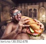Купить «Man with sandwich», фото № 30552678, снято 11 июня 2015 г. (c) Tryapitsyn Sergiy / Фотобанк Лори