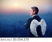 Купить «Businessman-angel», фото № 30554378, снято 13 января 2016 г. (c) Tryapitsyn Sergiy / Фотобанк Лори