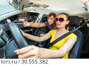 Couple travelling by car in the mountains. Стоковое фото, фотограф Tryapitsyn Sergiy / Фотобанк Лори