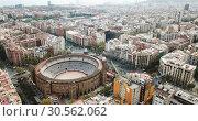 Купить «Aerial view of Eixample district and La Monumental, bullfighting arena of Barcelona, Catalonia, Spain», видеоролик № 30562062, снято 25 декабря 2018 г. (c) Яков Филимонов / Фотобанк Лори