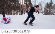 Купить «Пара мужчин тянут женщину на ледянке. Веселые старты моржей в Заводоуковске», эксклюзивное фото № 30562078, снято 3 марта 2019 г. (c) Анатолий Матвейчук / Фотобанк Лори