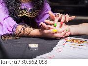 Купить «Sorceress reading somebody's hand», фото № 30562098, снято 27 июля 2016 г. (c) Tryapitsyn Sergiy / Фотобанк Лори
