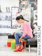 Купить «Woman fitting stilettos», фото № 30562342, снято 9 сентября 2016 г. (c) Tryapitsyn Sergiy / Фотобанк Лори