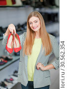 Happy woman in shoe store. Стоковое фото, фотограф Tryapitsyn Sergiy / Фотобанк Лори