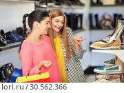 Купить «Women shopping», фото № 30562366, снято 9 сентября 2016 г. (c) Tryapitsyn Sergiy / Фотобанк Лори