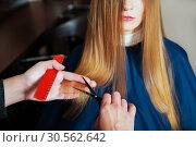 Купить «Hairdresser with scissors and comb», фото № 30562642, снято 28 сентября 2016 г. (c) Tryapitsyn Sergiy / Фотобанк Лори
