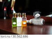 Haircare balms in flask and hairbrush. Стоковое фото, фотограф Tryapitsyn Sergiy / Фотобанк Лори