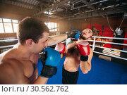 Купить «Boxer sents his opponent to the knockout.», фото № 30562762, снято 7 октября 2016 г. (c) Tryapitsyn Sergiy / Фотобанк Лори