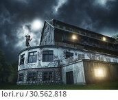 Купить «Scary zombie girl on a balcony of the spooky house», фото № 30562818, снято 8 октября 2016 г. (c) Tryapitsyn Sergiy / Фотобанк Лори