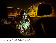 Horror zombie woman with bloody face in the car. Стоковое фото, фотограф Tryapitsyn Sergiy / Фотобанк Лори