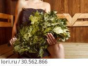 Woman in sauna with a broom in hands. Стоковое фото, фотограф Tryapitsyn Sergiy / Фотобанк Лори