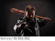 Купить «Killer with bloody bat on black background.», фото № 30563302, снято 7 ноября 2016 г. (c) Tryapitsyn Sergiy / Фотобанк Лори