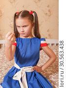 Купить «Angry girl shows fist.», фото № 30563438, снято 24 ноября 2016 г. (c) Tryapitsyn Sergiy / Фотобанк Лори