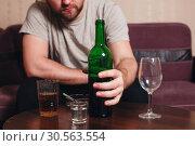 Anonymous alcoholic person hard drinking. Стоковое фото, фотограф Tryapitsyn Sergiy / Фотобанк Лори