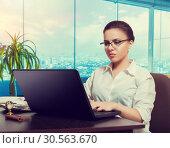 Female bookkeeper in glasses using laptop. Стоковое фото, фотограф Tryapitsyn Sergiy / Фотобанк Лори