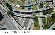 Купить «Aerial view of highway grade separation in Barcelona, Spain», видеоролик № 30563678, снято 12 июня 2018 г. (c) Яков Филимонов / Фотобанк Лори