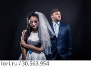 Tear-stained bride and brutal groom in suit. Стоковое фото, фотограф Tryapitsyn Sergiy / Фотобанк Лори