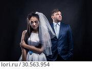 Купить «Tear-stained bride and brutal groom in suit», фото № 30563954, снято 3 декабря 2016 г. (c) Tryapitsyn Sergiy / Фотобанк Лори