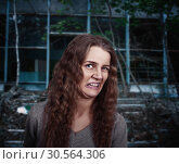 Young woman with face depicting disgust. Стоковое фото, фотограф Tryapitsyn Sergiy / Фотобанк Лори