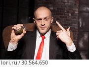 Купить «Killer in suit and tie ready to pull a grenade pin», фото № 30564650, снято 19 января 2017 г. (c) Tryapitsyn Sergiy / Фотобанк Лори